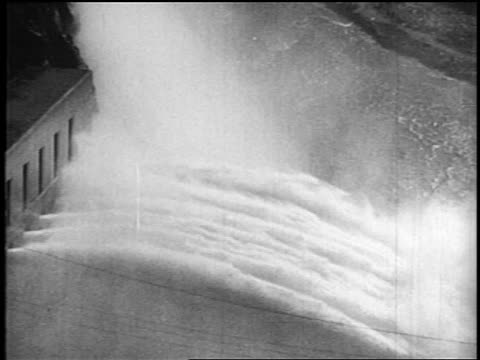 b/w 1936 huge jets of water flowing from valves of hoover dam / nevada / newsreel - hoover dam stock videos and b-roll footage
