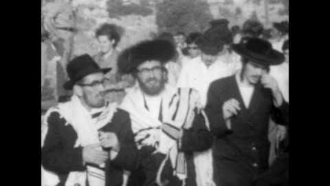 huge line of orthodox jews walking to the wailing wall in jerusalem / everyone happy, smiling and singing / packed crowd stand in front of wailing... - 1967 stock videos & royalty-free footage