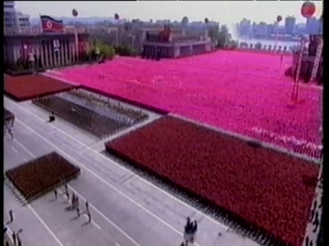 Huge marching army parade before leader Kim Jong Il performing synchronised display North Korea 11 Mar 03