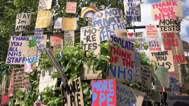 huge memorial wall of cardboard placards and signs of support of national health service staff and all other key workers during the coronavirus... - memorial stock videos & royalty-free footage