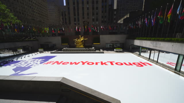 """huge """"new york tough"""" sign appears at rockefeller center ice skate rink during the quarantine for new york state on pause order of covid-19 at new york ny usa on may 21 2020. - ice rink stock videos & royalty-free footage"""