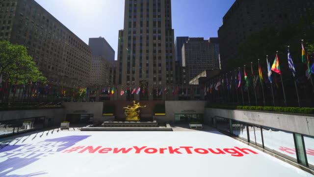 "vídeos de stock e filmes b-roll de huge ""new york tough"" sign appears at rockefeller center ice skate rink during the quarantine for new york state on pause order of covid-19 at new york ny usa on may 21 2020. - pista de patinagem no gelo"