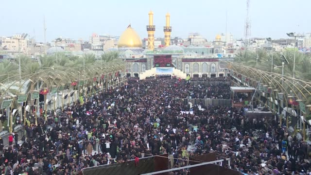 huge numbers of shiite muslim pilgrims arrived friday in the iraqi city of karbala to take place in the annual arbaeen commemorations which marks the... - imam hussein stock videos and b-roll footage