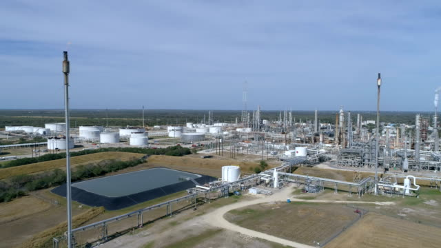 Huge Oil Refinery with Pipes and Burn off Smoke Stacks and large Petro Chemical Power Plant