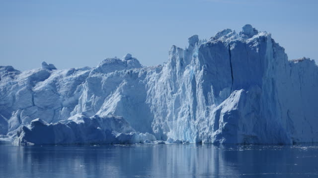 Huge piece of ice tilts during the iceberg is calving