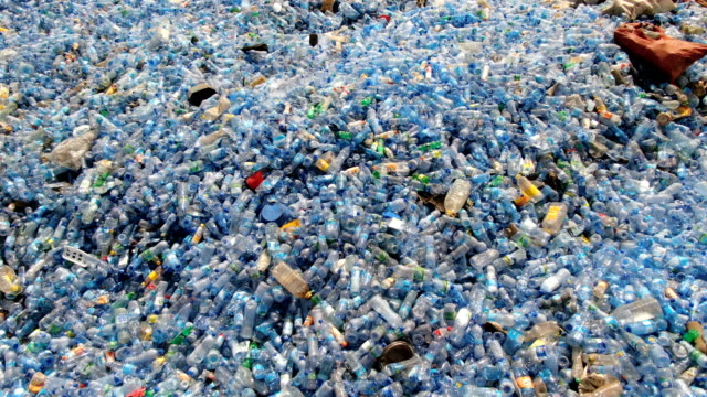 vidéos et rushes de huge piles of used blue mineral water plastic bottles waiting for  recycling / aerial drone shot - environnement