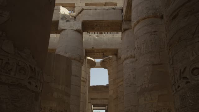 huge pillars at the temple of karnak, near luxor, egypt. - temples of karnak stock videos and b-roll footage
