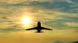 Huge plane flies overhead at sunrise, UHD stock video