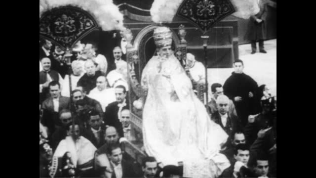 / huge procession for pope's 80th birthday / pope being escorted through massive crowds / pope blessing the crowds as he passes / church service led... - 1956 stock videos and b-roll footage