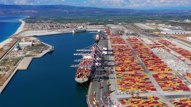 huge quantity of containers with a container ship export and import business and logistics. - suezkanalen bildbanksvideor och videomaterial från bakom kulisserna