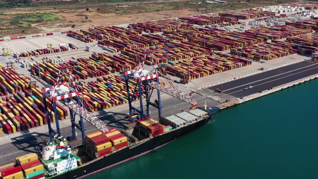 huge quantity of containers with a container ship export and import business and logistics. - suez canal stock videos & royalty-free footage