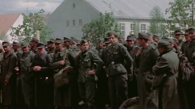 pan huge queue of prisoners of war waiting outside pow camp / germany - prisoner of war stock videos & royalty-free footage
