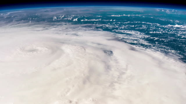 huge real hurricane seen from space 4k timelapse - weather stock videos & royalty-free footage