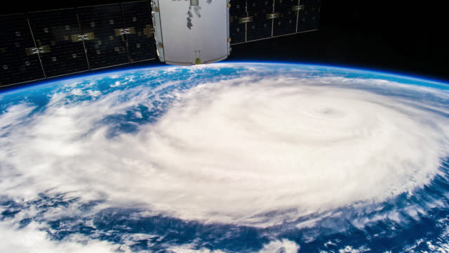 vídeos de stock e filmes b-roll de huge real hurricane seen from space 4k timelapse - condições meteorológicas