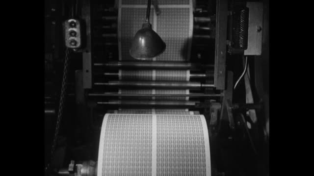 huge rolls of coronation commemorative stamps are being made / cu sheets of stamps turning on rollers / girl supervises cutting of stamp sheets / cu... - coronation stock videos and b-roll footage