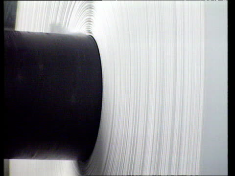 huge rotating roll of paper at paper mill - paper mill stock videos & royalty-free footage