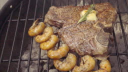 Huge T-Bone Steak with Jumbo Shrimp on Barbecue