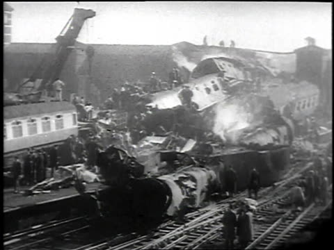 vidéos et rushes de huge train crash with crowds around destroyed train and injured and dead being carried away / london, united kingdom - 1952