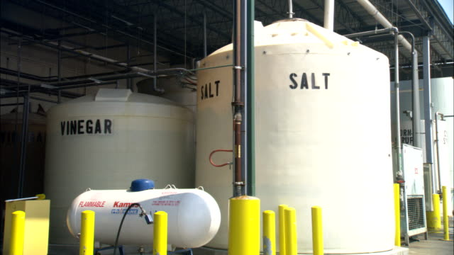 huge vats of salt and vinegar occupy a pickle factory. - mineral stock videos & royalty-free footage