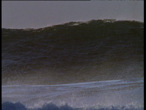 huge wave rears up and rolls towards coast, ireland - tsunami stock videos & royalty-free footage