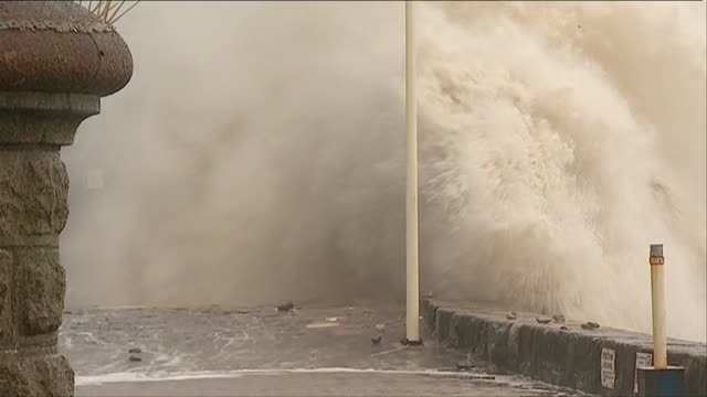 Huge waves crash into sea walls and batter coastline in the Devon town of Dawlish during severe weather conditions