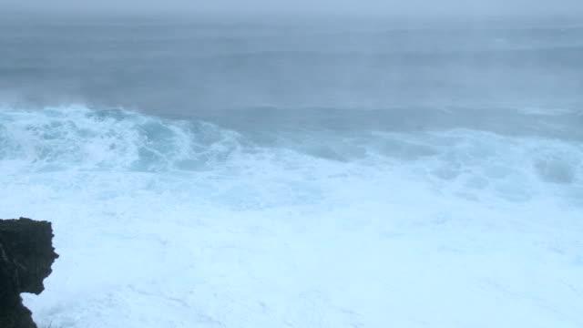 huge waves crash into the coastline of miyakojima japan as typhoon neoguri nears - tropical storm stock videos & royalty-free footage