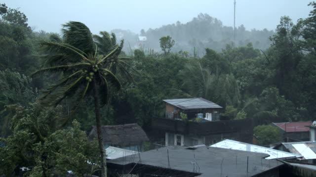 huge waves crash into the coastline of miyakojima, japan as typhoon neoguri nears - pacific ocean stock videos & royalty-free footage