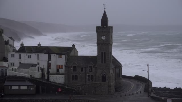 huge waves crash into the cornish coast behind the famous town hall at the end of the historic harbour as storm ciara arrives on sunday morning - storm stock videos & royalty-free footage