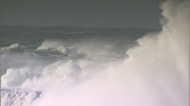 huge waves swell and crash over the ocean. - tide stock videos & royalty-free footage