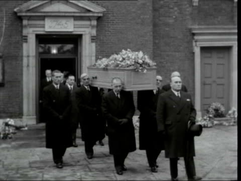 hugh gaitskell funeral held in hampstead; england: london: hampstead: st john-at-hampstead: ext james griffiths mp and winifred griffiths arriving... - steeple stock videos & royalty-free footage
