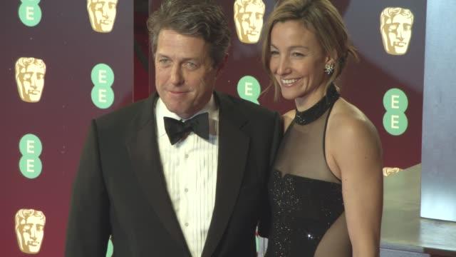 hugh grant anna elisabet eberstein at ee british academy film awards at royal albert hall on february 12 2017 in london england - 英国アカデミー映画賞点の映像素材/bロール