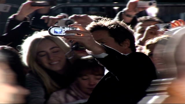 hugh grant arrested for apparent assault on photographer; r05020707 leicester square: ext / night grant signing autographs hugh grant interview sot i... - interview raw footage stock videos & royalty-free footage