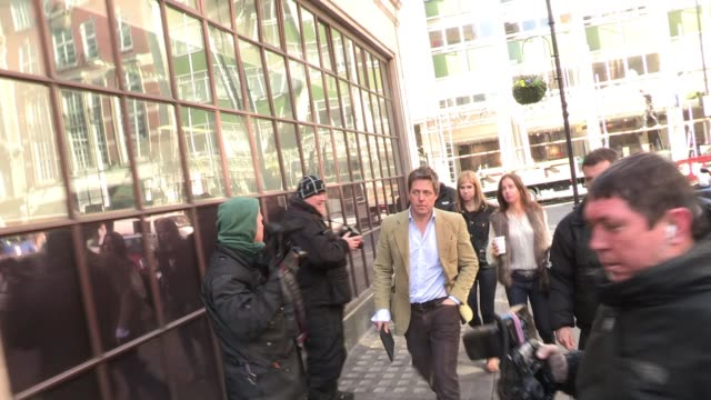 hugh grant arrives at bbc radio one to promote the soon to be released movie 'the pirates'. sighted: hugh grant at bbc radio, central london on march... - bbc radio stock videos & royalty-free footage