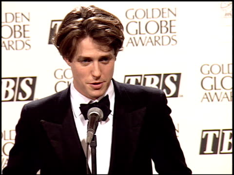 hugh grant at the 1995 golden globe awards at the beverly hilton in beverly hills, california on january 21, 1995. - golden globe awards stock-videos und b-roll-filmmaterial