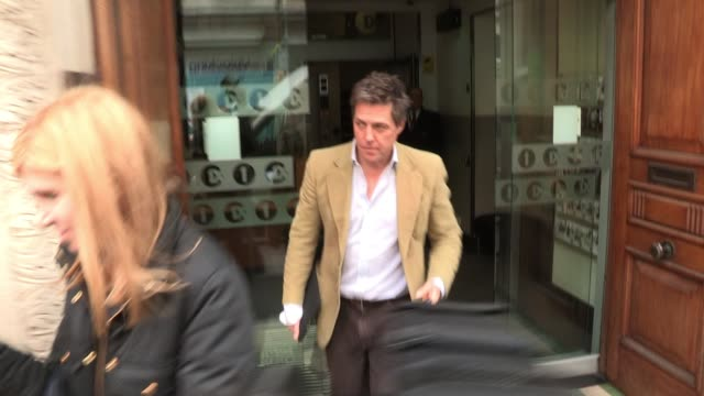 hugh grant leaves bbc radio one after promoting the soon to be released movie 'the pirates'. sighted: hugh grant at bbc radio, central london on... - bbc radio stock videos & royalty-free footage