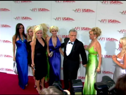 Hugh Hefner and playmates at the 33rd AFI Life Achievement Award 'A Tribute to George Lucas' at the Kodak Theatre in Hollywood California on June 9...