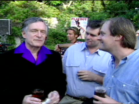 ms hugh hefner conversing with dick kingsley and dick skinner in backyard at playboy mansion - playboy mansion stock videos & royalty-free footage