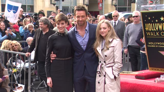 Hugh Jackman Anne Hathaway and Amanda Seyfried at Hugh Jackman Honored with Star on the Hollywood Walk of Fame on 12/13/12 in Hollywood CA