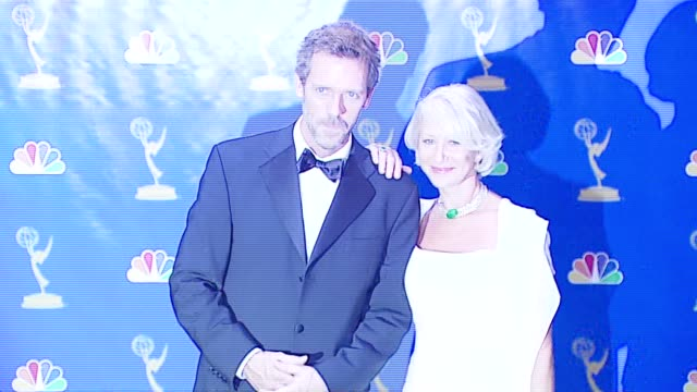 Hugh Laurie and Helen Mirren presenters at the 2006 Emmy Awards press room at the Shrine Auditorium in Los Angeles California on August 27 2006