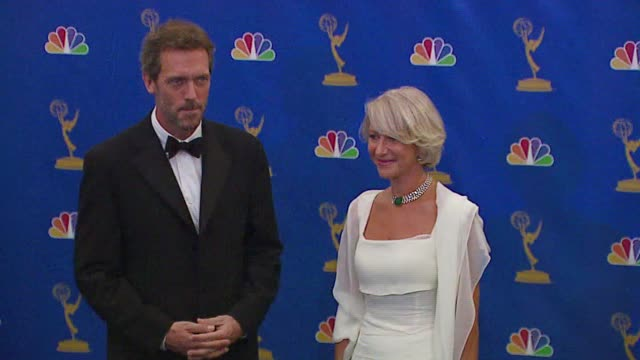 hugh laurie and helen mirren, presenters at the 2006 emmy awards press room at the shrine auditorium in los angeles, california on august 27, 2006. - hugh laurie stock videos & royalty-free footage