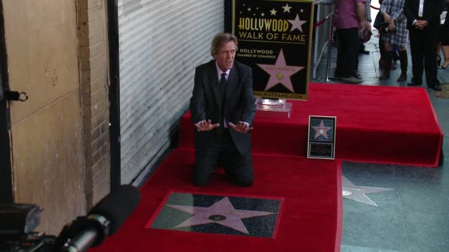 hugh laurie at hugh laurie honored with star on the hollywood walk of fame on october 25, 2016 in hollywood, california. - hugh laurie stock videos & royalty-free footage