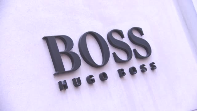 hugo boss signage at luxury brands in london at on january 25, 2016 in london, england. - hugo boss stock videos & royalty-free footage