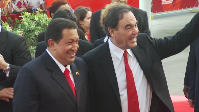 hugo chavez oliver stone at the south of the border red carpet venice film festival 2009 at venice - ウゴ・チャベス点の映像素材/bロール