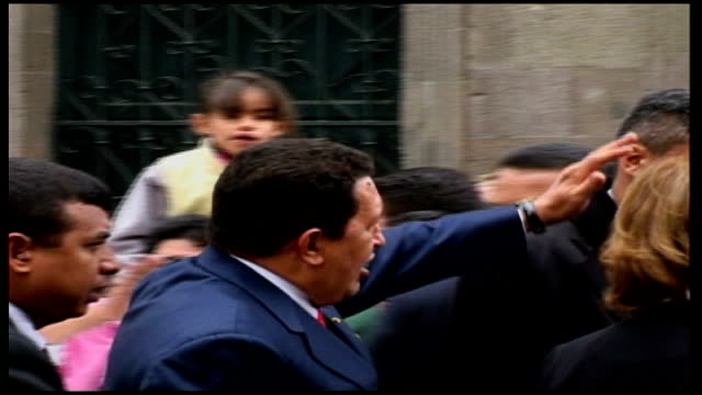 hugo chavez set to win third term in power date chavez out of car and along through crowd - ウゴ・チャベス点の映像素材/bロール
