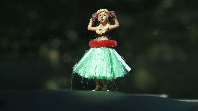hula dancer ornament on car dashboard - female likeness stock videos & royalty-free footage