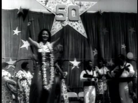 Hula dancer performing on stage at ceremony celebrating Hawaiian statehood / Hawaii USA / AUDIO