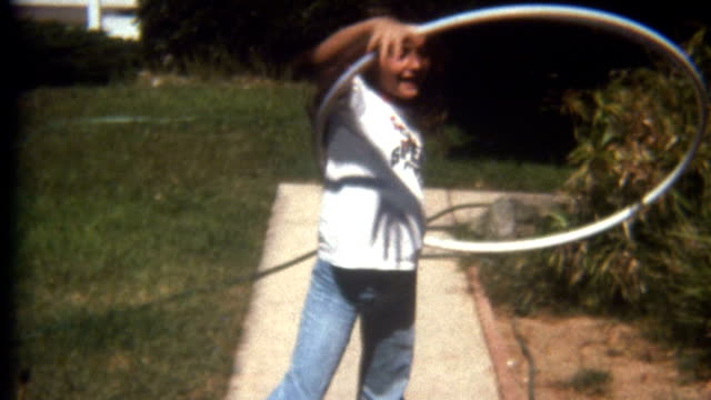 hula hoop 1960's - archival stock videos & royalty-free footage