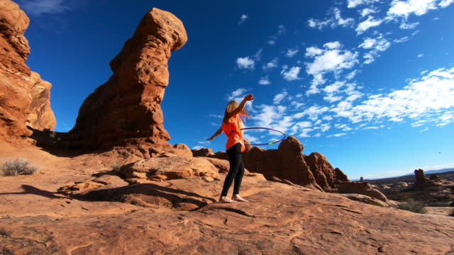hula hoop outdoors, woman at arches national park - arches national park stock videos & royalty-free footage