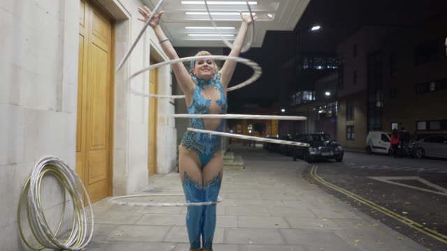 hula hooping at night. - blonde hair stock videos & royalty-free footage