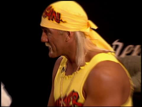 vídeos de stock e filmes b-roll de hulk hogan at the natpe convention on january 25, 1995. - natpe convention